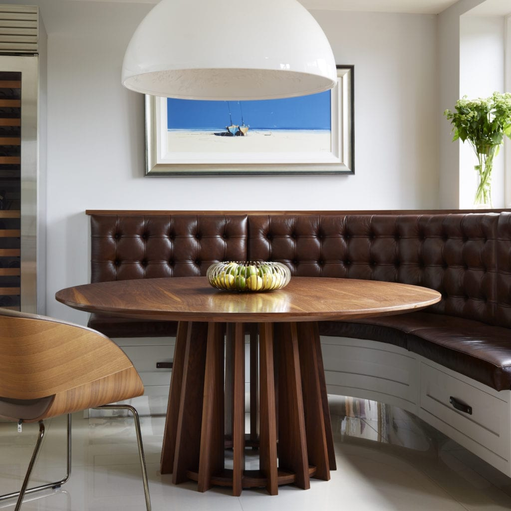 Davonport Designed Curved, Deep Button Leather Bench Seat With Additional Seating In The Form Of Chairs Around A Beautiful Bespoke Dining Table